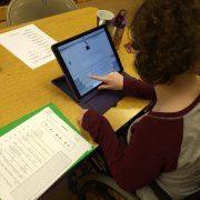 Vision Academics; Lillian with iPad
