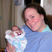 Michele Shusterman Holdering her Newborn Daughter