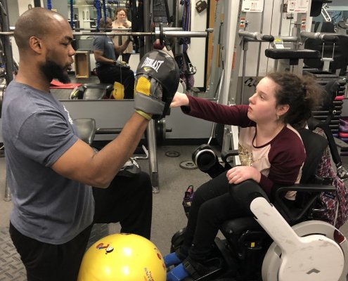 Lillian Working with her Personal Trainer