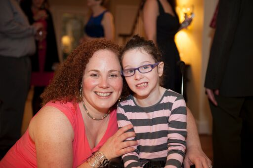Michele Shuterman, Co-Founder of CPRN, with her daughter, Lillian, leaning into eachother, smiling.