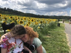 CP Research Network co-founder and her daughter Lilly in a field of sunflowers.