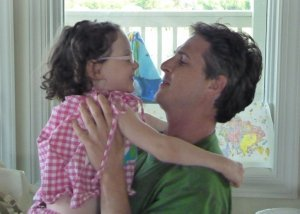 Blake hugs Lilly -- Knowing the cause of cerebral palsy can help parents understand more about the life course with CP