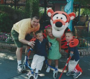 Dr. Wade Shrader with his triplets at Disneyland in 2002.
