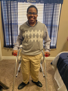 In high school, Marquise got up very early to make sure he dressed himself – here in khakis and a grey argyle sweater.